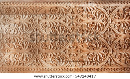 Pattern of old carved door on wood background, Georgia country traditional craftsmanship