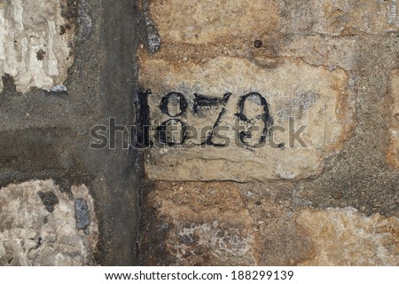 Pattern of old stone wall with date, Catacombe, Paris