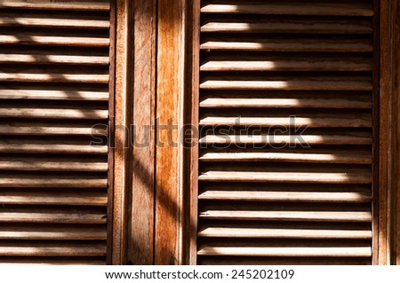 Pattern of old wood window in the sunlight - stock photo