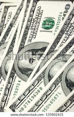Pattern of one hundred dollar bills pile. - stock photo