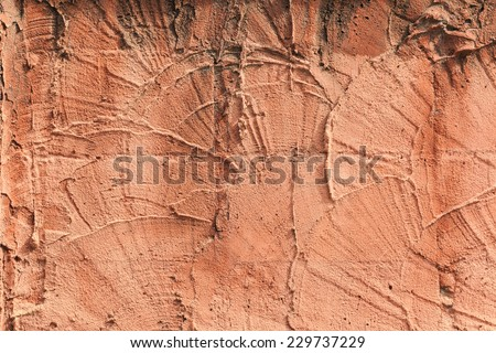 pattern of orange cement wall