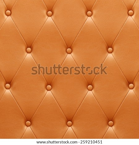 Pattern of orange leather seat upholstery use for background - stock photo
