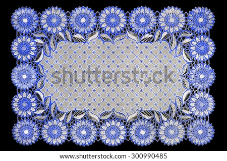 Pattern of Plastic blue floral for tablecloth isolated on black background - stock photo