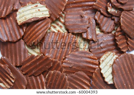 Pattern of Ridged potato chips cover with Chocolate using as background - stock photo