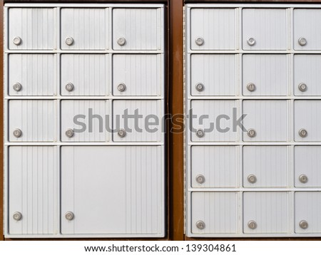 Pattern of rows of lockers with metal doors and locks of outdoor silver canadian mailboxes for safe delivery of rural mail post