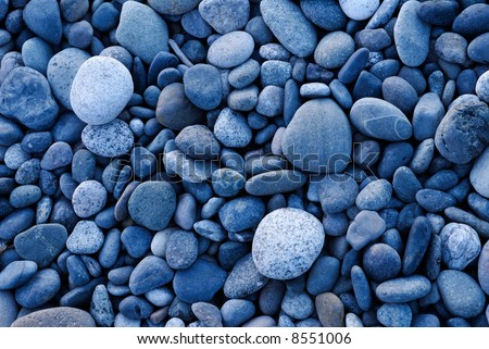 Pattern of smooth rounded rocks - stock photo