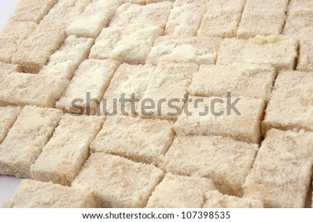 pattern of sweet pastries sprinkled with powdered milk