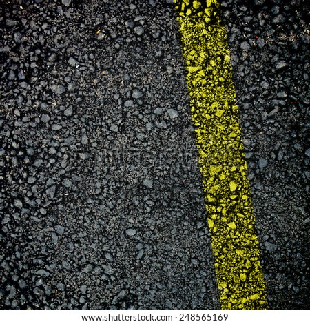 Pattern of the fresh  asphalt surface with yellow line - stock photo