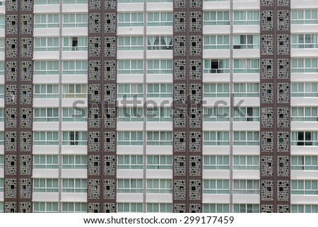 Pattern of windows in condominium room with attached small balcony - stock photo