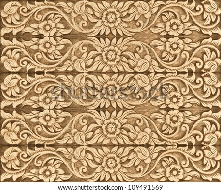 Pattern of wood flower carve as background - stock photo