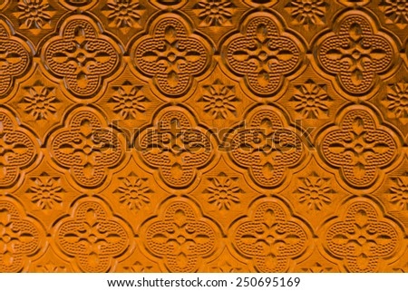 Pattern on Background corrugated yellow glass - stock photo