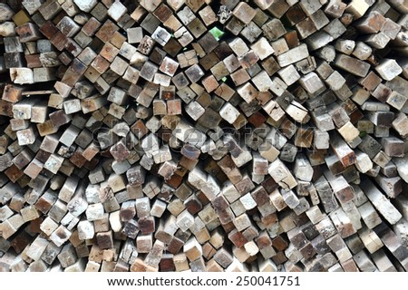 pattern on stacks of old logs background - stock photo