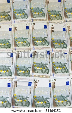 Pattern texture of several 5 euro banknote; money background - stock photo