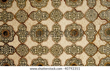 Patterned artwork in the ceiling in one of the Amber Fort palaces, India - stock photo
