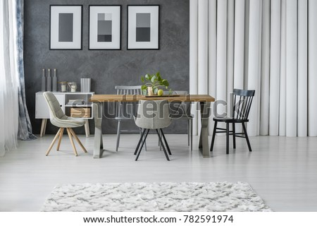 Patterned Carpet In Grey Dining Room With Wooden Table And Chairs Next To Cupboard Paper