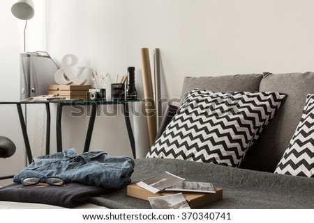 Patterned cushions on the bed in modern bedroom - stock photo