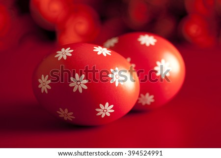 Patterned Easter eggs on red background - stock photo