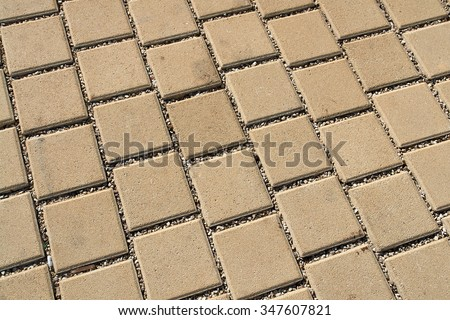 Patterned light brown paving street tiles on the road                                - stock photo