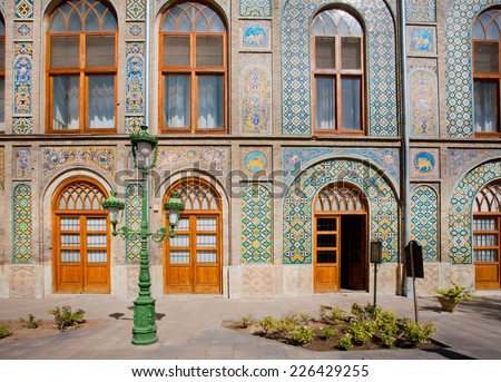 Patterned walls and wooden doors of the royal palace Golestan in Tehran, Iran. Golestan Palace is the oldest groups of buildings in persian capital, was rebuilt to its current form in 1865 - stock photo