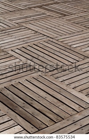 Patterns and textures of a wooden planks pavement - stock photo