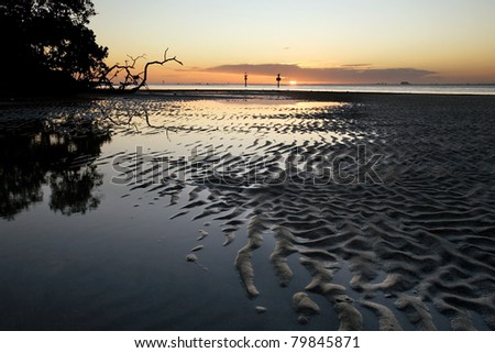 Patterns in sand in tidal flat at sunset, Florida - stock photo