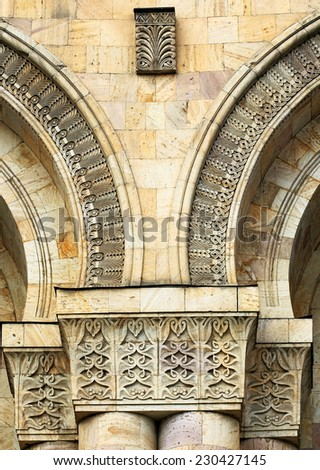 Patterns of armenian national subjects on a stone columns   - stock photo