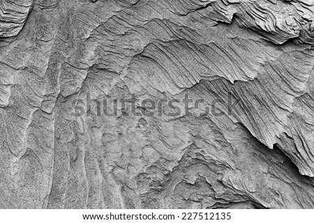 patterns of erosion of sand in the background - stock photo