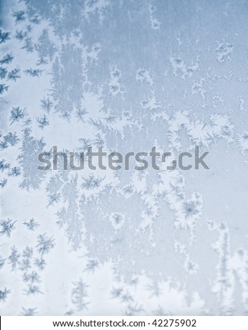 patterns of frosty ice on a window - stock photo
