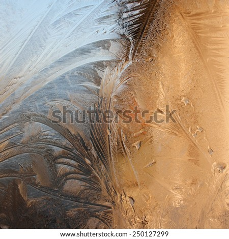 Patterns on glass in the frosty winter day - stock photo