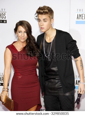 Pattie Malette and Justin Bieber at the 2012 American Music Awards held at the Nokia Theatre L.A. Live in Los Angeles, USA on November 18, 2012. - stock photo