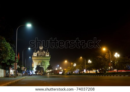 patuxai arch at night in central vientiane, laos