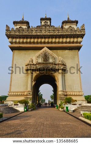 Patuxai literally meaning Victory Gate or Gate of Triumph, formerly the Anousavary or Anosavari Monument, known by the French as Monument Aux Morts) is a war monument in the centre of Vientiane, Laos - stock photo