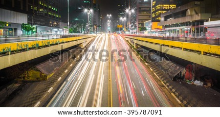 Paulista Avenue is the most famous public space in the city of Sao Paulo, Brazil. It is the business center of the city translating into a large amount of cars and buses at any time of the day.