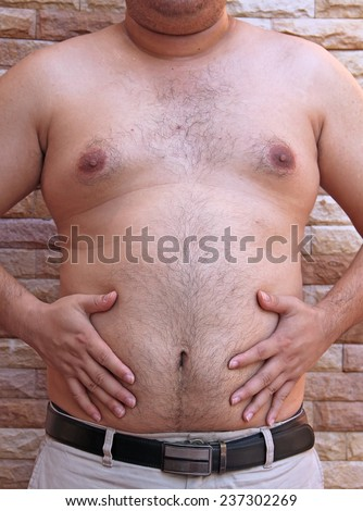 paunch Fat man - stock photo