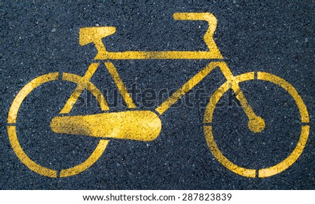 Paved cycle lane with yellow bicycle symbol