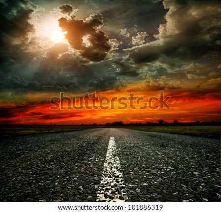 paved road at sunset - stock photo