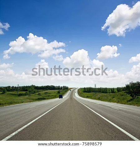 paved road between the hills