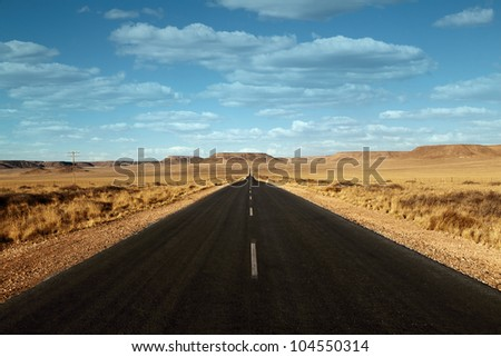 paved road in the desert with clouds Namibia Africa