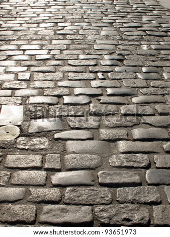 paved road of an old town - stock photo