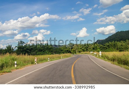 Paved roads in the countryside with blue sky white clouds background. - stock photo