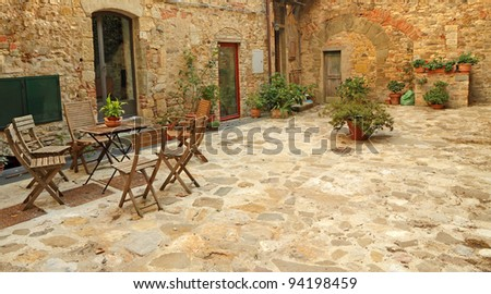 paved rustic terrace in Tuscany, Italy, Europe - stock photo