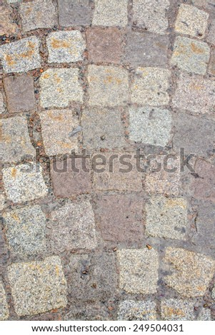 Pavement detail granite. Pavement stones in warm colors by red granite and other igneous rocks native to western Sweden. - stock photo