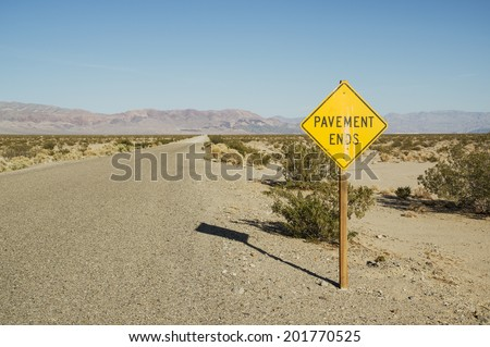 pavement ends road sign along the Death Valley Road in California - stock photo