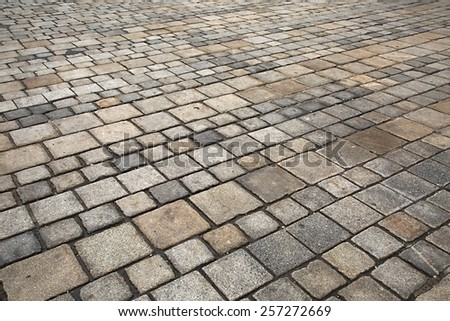 Pavement made of old stones - stock photo