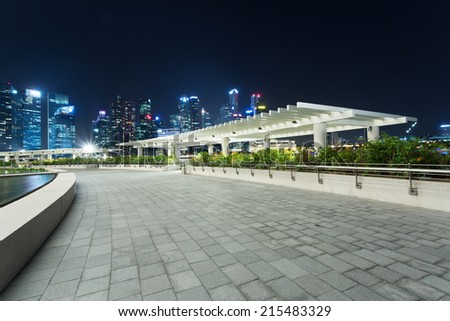 pavement on the roof of building and cityscape at night - stock photo