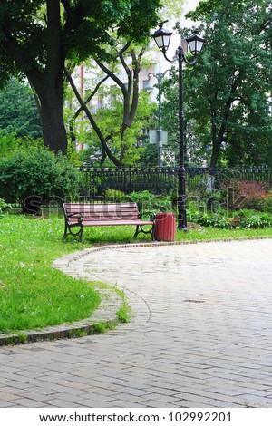 Pavement road leading to the bench in Mariinsky Park in Kiev - stock photo