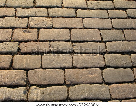 Pavement texture. Background of old cobblestone pavement. Pavement road, stone.