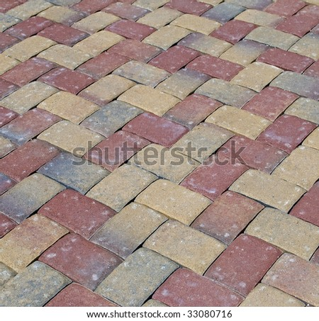 Paver patio with herringbone pattern - stock photo