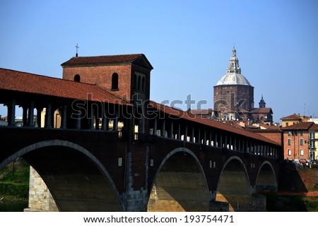PAVIA , ITALY - APR 19: Old bridge of Pavia  April 19, 2013 in Pavia, Italy.  - stock photo