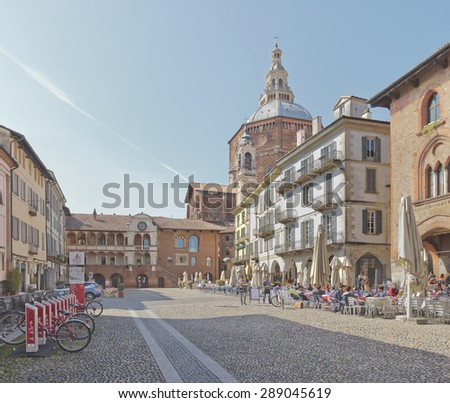PAVIA, ITALY - APRIL 04, 2014: Piazza della Vittoria (Victory square) with main cathedral (Duomo) on the background